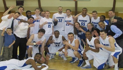 Cabrini's men's basketball team celebrating